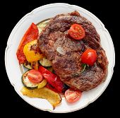 pic of wagyu  - Kobe beef ribeye steak with grilled vegetables on old table isolated on black - JPG