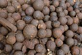 image of cannonball  - Big pile of an old rusty cannonballs - JPG