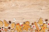 image of gingerbread house  - Homemade various christmas gingerbread cookies on wooden background - JPG