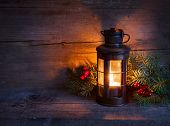 pic of candle flame  - Cristmas lantern  in night on old wooden background - JPG