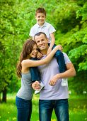 stock photo of father time  - Happy family of three - JPG