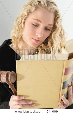 Beautiful Blonde Woman Reading Old Law Book