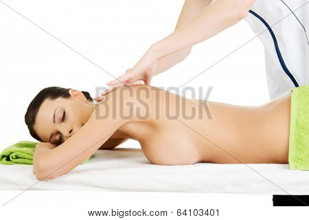 Preaty young woman relaxing heaving massage therapy in spa saloon