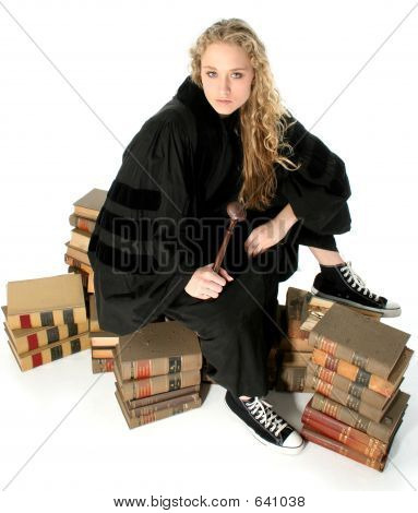 Young Blonde Judge Sitting On 70 Year Old Law Books