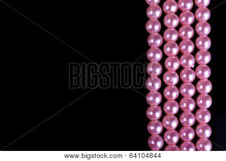 Beautiful pearls on black background