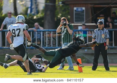 VIENNA,  AUSTRIA - JUNE 8 RB Tunde Ogun (#1 Dragons) scores a touchdown during the AFL football game on June 8, 2013 in Vienna, Austria.