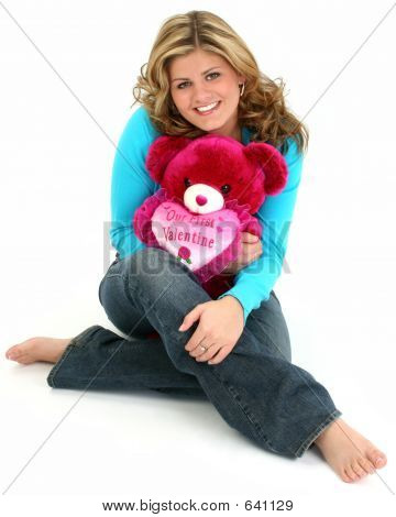Blonde Woman Hugging Bear
