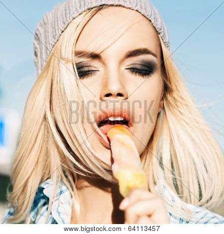 Beautiful Blonde Girl In Beanie Hat With Smokey Eye Make Up Who Enjoys Licking Ice Cream