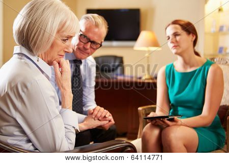 Older Couple Talking To Counsellor Using Digital Tablet