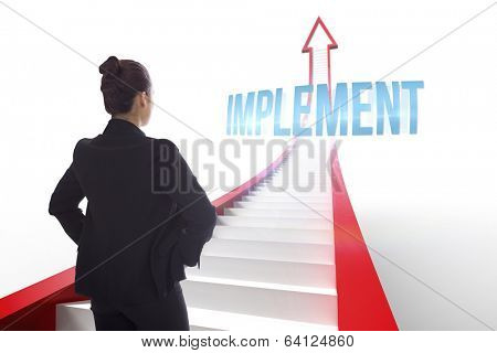 The word implement and businesswoman with hands on hips against red arrow with steps graphic