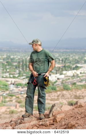 Rock Climber On Mountain Ledge