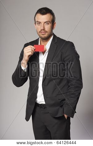 Relaxed fashionable man in suit standing casually