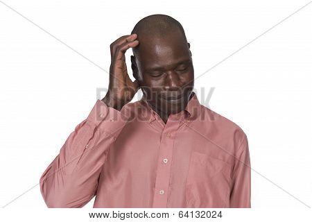 Black Man Scratching His Head