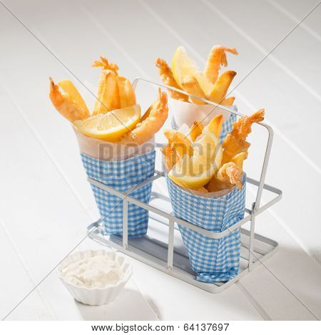 Cones of tempura prawns and fries with tartar sauce