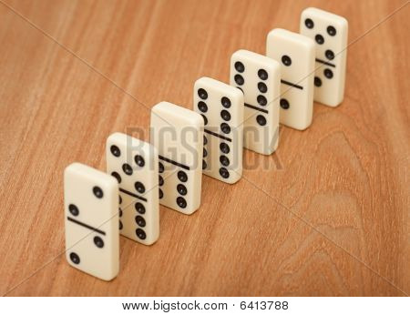 Line From Seven Dominoes On Wooden Surface