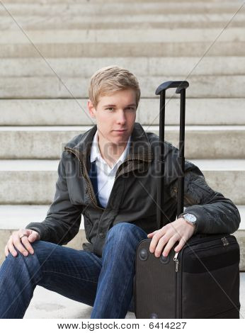 Young Blond Man With Suitcase