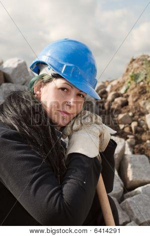 Female Worker In Blue Hardhat