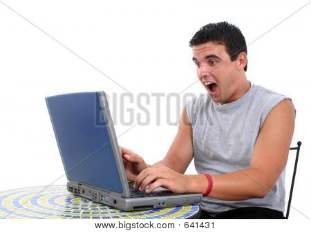 Stock Photography: Attractive Young Man Working On Laptop With S
