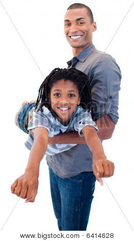 Afro-american Father Playing With His Son