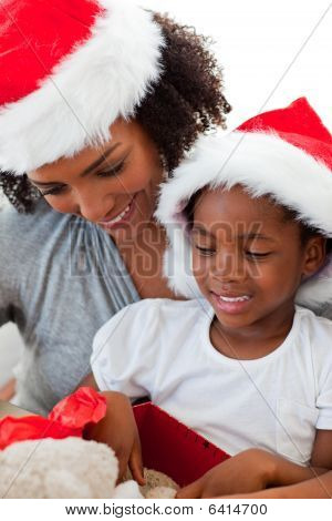 Afro-american Mother And Daughter Opening A Christmas Gift