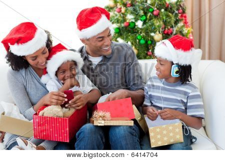 Happy Afro-american Family Opening Christmas Presents