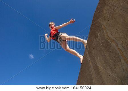 Teen Girl Jumping Blue Sky
