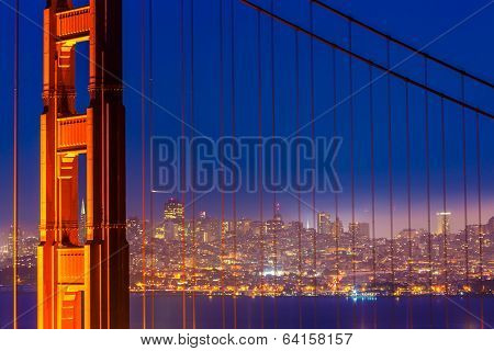 San Francisco Golden Gate Bridge sunset view through cables in California USA