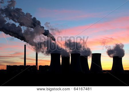 Smoke From Coal Power Plant Under Sunset Sky
