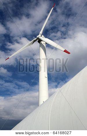 Detail Of Wind Mill Power Turbine Under Cloudy Sky