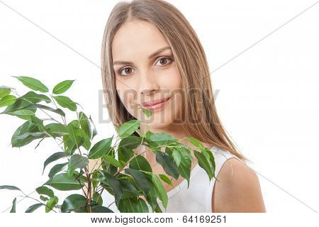 female face behind grin foliage plant , isolated on white background