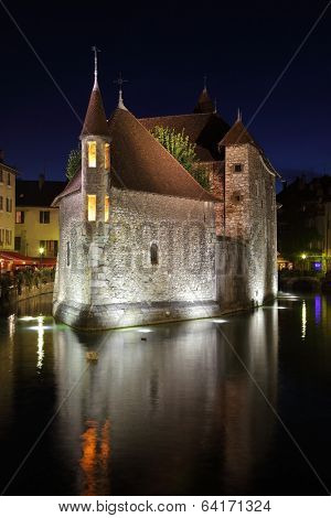 ANNECY, FRANCE - SEPTEMBER 16, 2012: Capital of the department of Haute-Savoie - Annecy. The  ancient fortress-prison on an island in the middle of the river