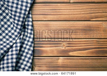 the background made from checkered napkin on wooden table