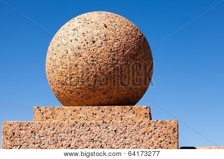 Stone Ball and Blue Sky