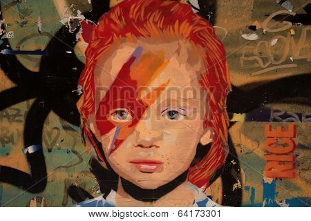 BARCELONA, SPAIN - MAY 8 2013 : A girls face appears on a public wall in the city.