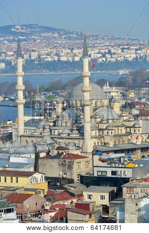 ISTANBUL, TURKEY - MARCH 23, 2014: Yeni Mosque against the Bosporus strait. Built in 1665, the mosque is situated on the Golden Horn, and is one of the famous architectural landmarks of Istanbul