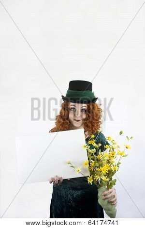 Girl in green with blank sign