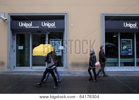 BOLOGNA, ITALY - APRIL 19, 2014: Pedestrians walk past a Unipol Banca S.p.A bank office in Bologna, Italy, on Saturday, April 19, 2014.