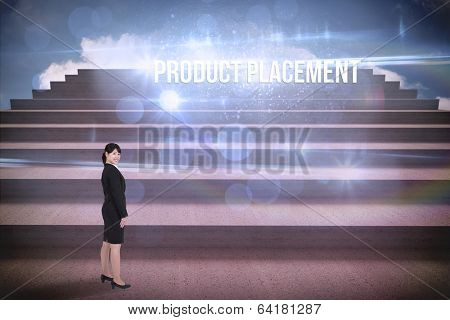 The word product placement and smiling businesswoman against steps against blue sky