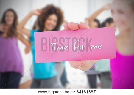 Fit blonde holding card saying time for me against dance class in gym