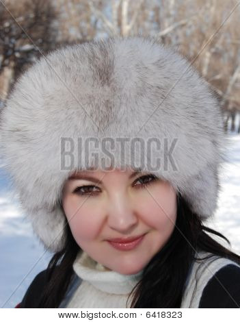 Portrait Of The Beautiful Young Woman On Walk During Winter Time