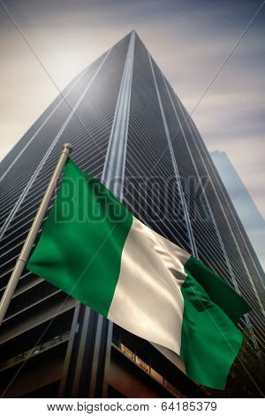 Nigeria national flag against low angle view of skyscraper