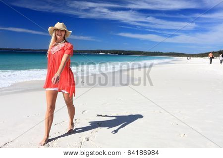 Happy Woman Walking Along Beautiful Beach