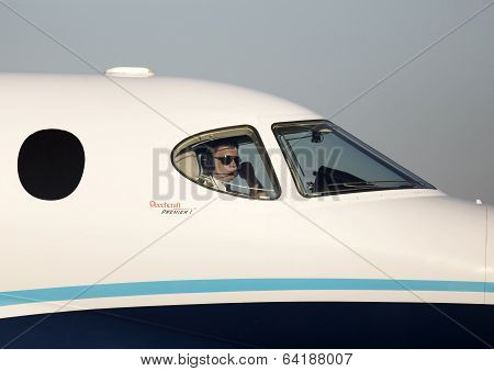 Pilot in the cockpit of the private jet