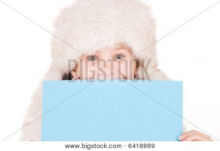 Girl In Winter Hat With Blank Board