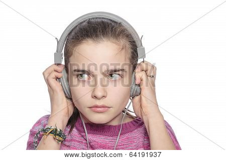 Teenage Girl Hears Something Scary On Headphones, Isolated On White