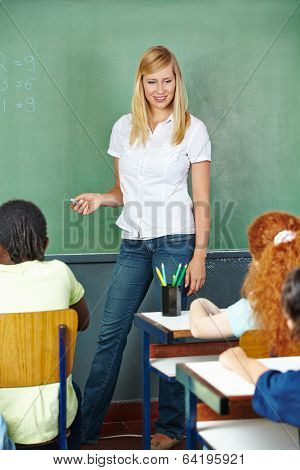 Teacher and students talking in elementary school class