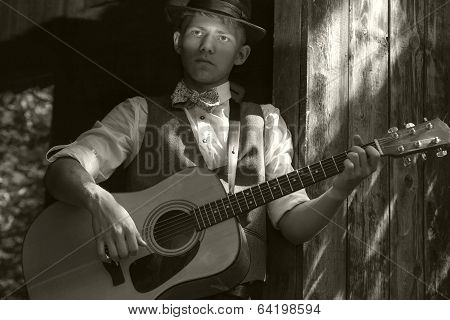 Young guitarist portrait. Old film retro effect