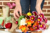 stock photo of compose  - Female hands composing beautiful bouquet - JPG