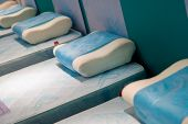 picture of futon  - Beds with blue matrasses and a white pillow - JPG