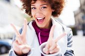 pic of funky  - Funky woman giving a peace sign - JPG